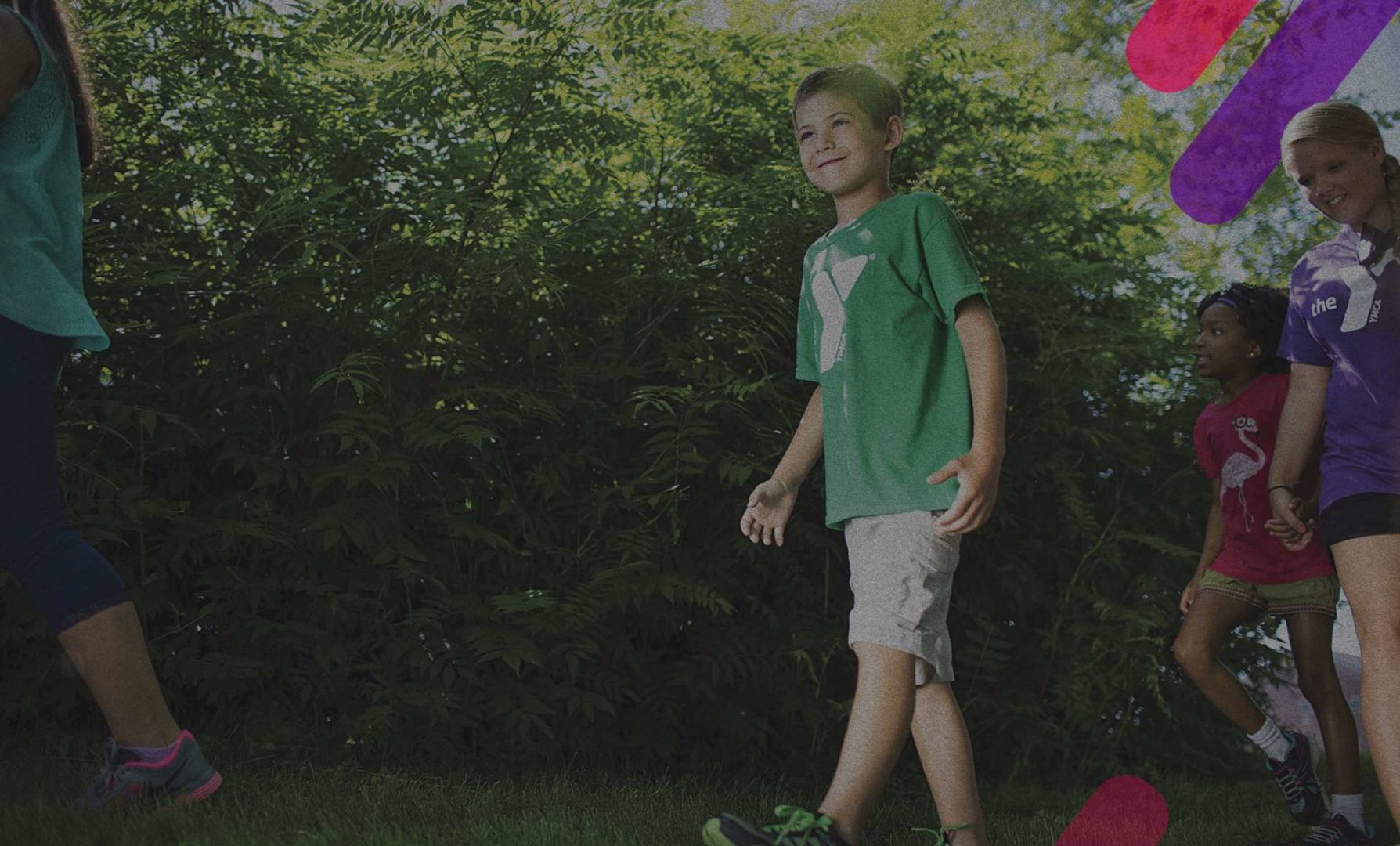 kids in YMCA t-shirts at an outdoor program